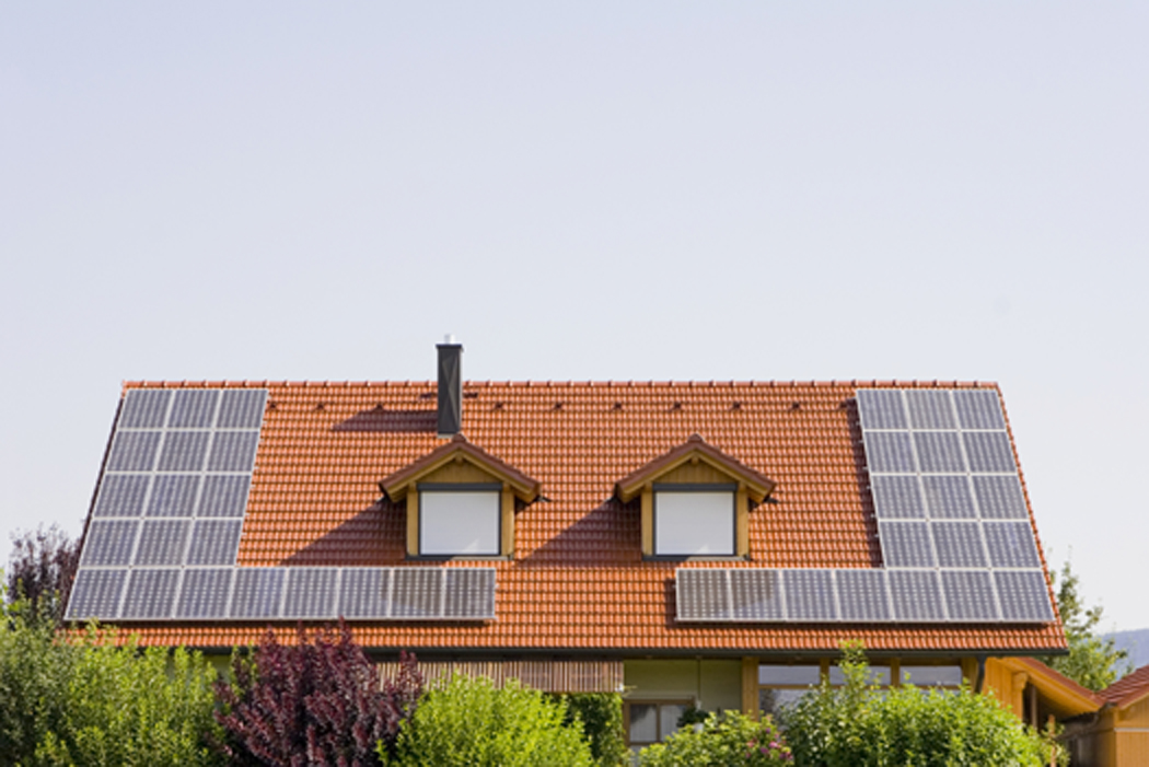 A View Of Solar Panels On The Roof Residential Building